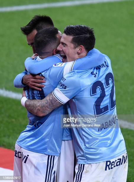 Iago Aspas of Celta de Vigo celebrates his team's second goal with teammates Santi Mina and Brais Mendez during the La Liga Santander match between...