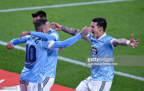 Iago Aspas of Celta de Vigo celebrates his team's second goal with teammates Santi Mina and Brais Mendez during the La Liga Santander match between...
