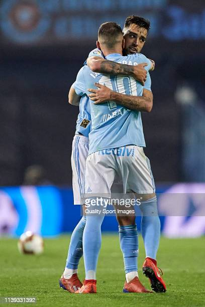 Iago Aspas of Celta de Vigo celebrates with Brais Mendez of Celta de Vigo after scoring his team's third goal during the La Liga match between RC...