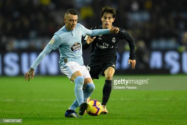 Iago Aspas of Celta de Vigo competes for the ball with Alvaro Odriozola of Real Madrid during the La Liga match between RC Celta de Vigo and Real...