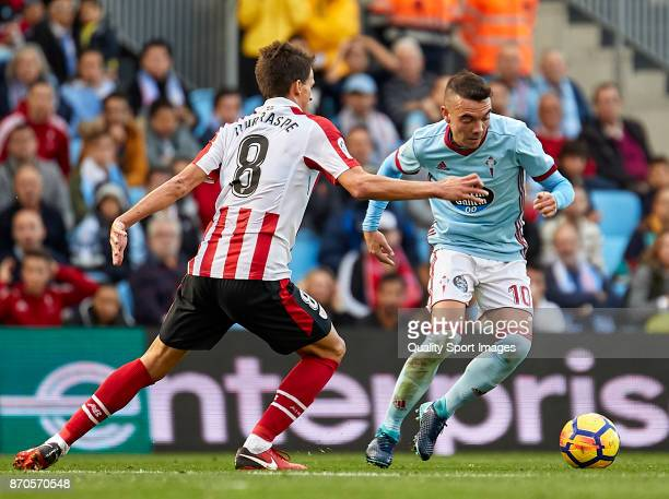 Iago Aspas of Celta de Vigo is challenged by Ander Iturraspe of Athletic de Bilbao during the La Liga match between Celta de Vigo and Athletic Club...