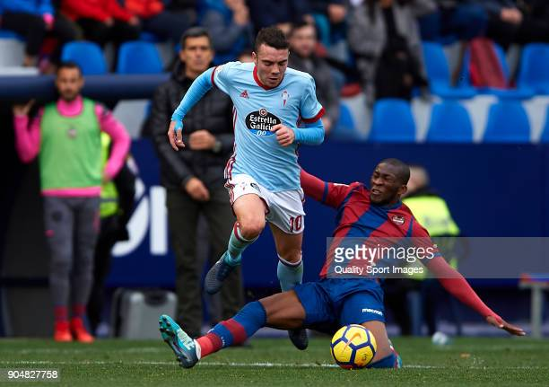 Iago Aspas of Celta de Vigo is tackled by Jefferson Lerma of Levante during the La Liga match between Levante and Celta de Vigo at Ciutat de Valencia...