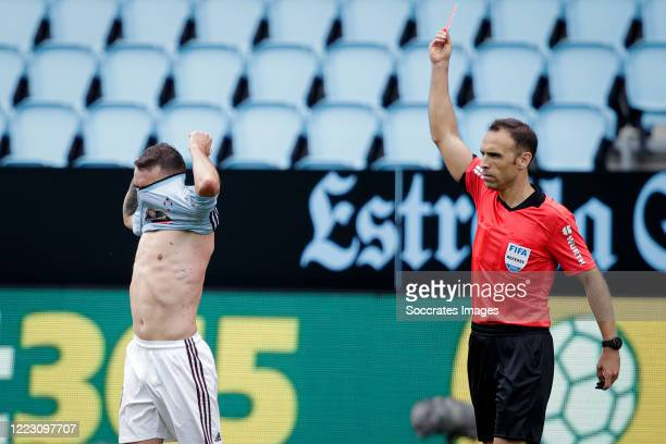 Iago Aspas of Celta de Vigo receives a red card during the La Liga Santander match between Celta de Vigo v FC Barcelona at the Estadio de Balaidos on...