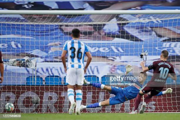 Iago Aspas of Celta de Vigo scores the first goal to make it 01 Alex Remiro of Real Sociedad during the La Liga Santander match between Real Sociedad...