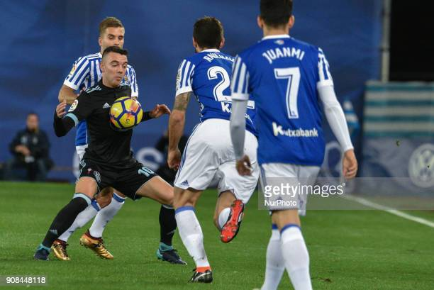 Iago Aspas of Celta duels for the ball with Kevin Rodrigues and Raul Navas of Real Sociedad during the Spanish league football match between Real...