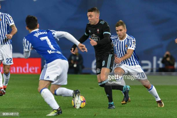 Iago Aspas of Celta duels for the ball with Kevin Rodrigues of Real Sociedad during the Spanish league football match between Real Sociedad and Celta...