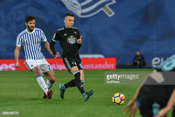 Iago Aspas of Celta duels for the ball with Raul Navas of Real Sociedad during the Spanish league football match between Real Sociedad and Celta at...
