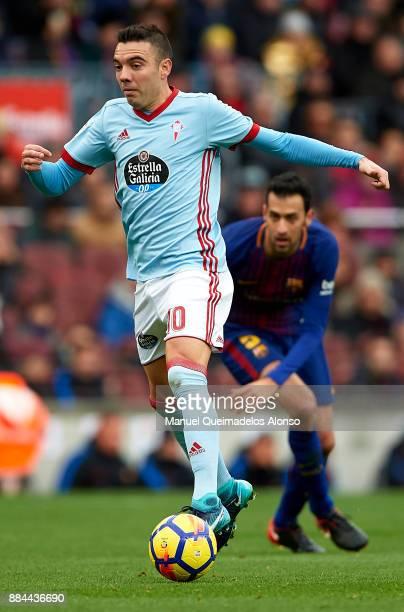 Iago Aspas of Celta runs with the ball during the La Liga match between Barcelona and Celta de Vigo at Camp Nou on December 2 2017 in Barcelona Spain