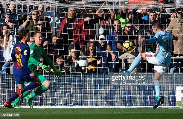 Iago Aspas of Celta scoring his team's first goal during the La Liga match between Barcelona and Celta de Vigo at Camp Nou on December 2 2017 in...