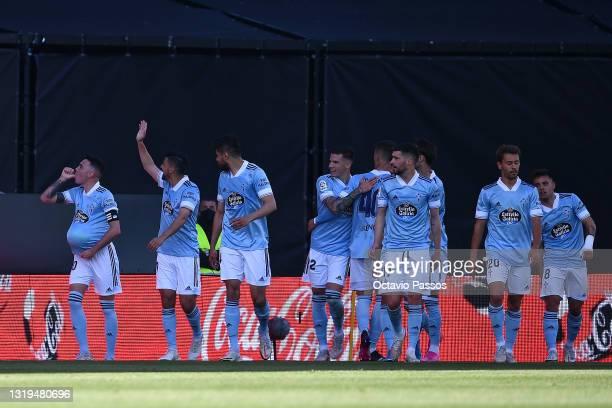 Iago Aspas of Celta Vigo celebrates with his team mates after scoring his side's first goal during the La Liga Santander match between RC Celta and...