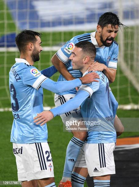 Iago Aspas of Celta Vigo celebrates with Nolito and Brais Mendez after scoring his sides second goal during the La Liga Santander match between RC...