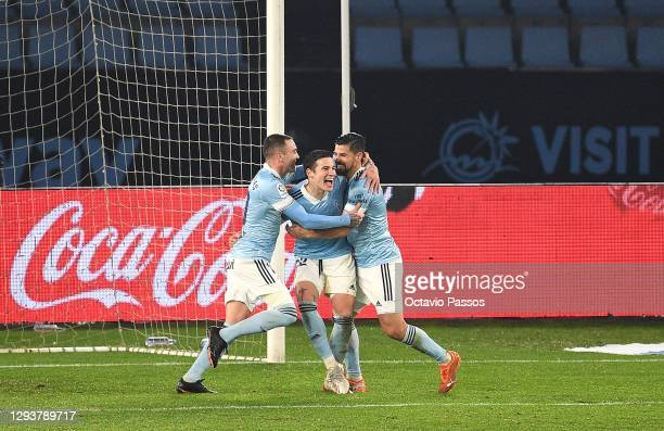 Iago Aspas of Celta Vigo celebrates with teammates Santi Mina and Nolito after scoring their team's second goal during the La Liga Santander match...