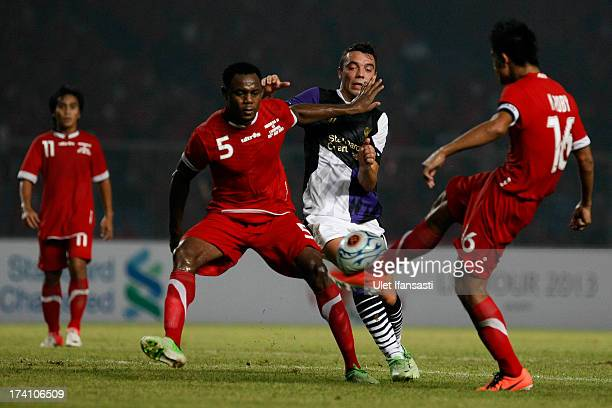 Iago Aspas of Liverpool competes for the ball with Victor Igbonefo of Indonesia XI during the match between the Indonesia XI and Liverpool FC on July...
