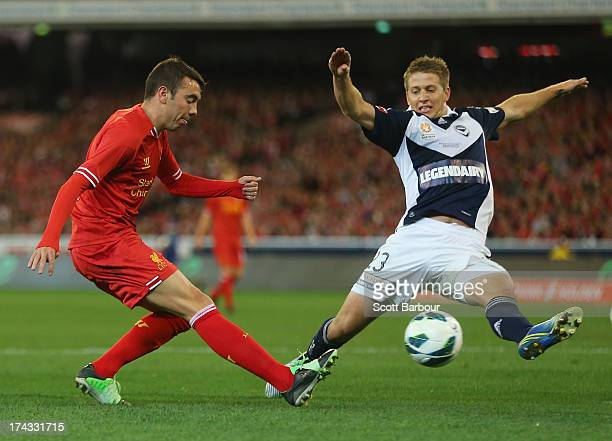 Iago Aspas of Liverpool takes a shot at goal as Adrian Leijer of the Victory defends during the match between the Melbourne Victory and Liverpool at...