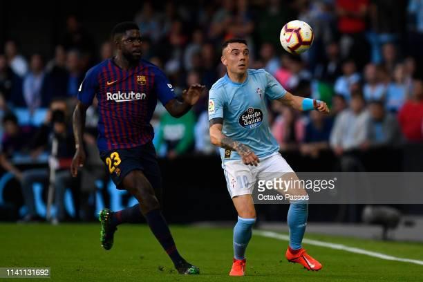 Iago Aspas of RC Celta competes for the ball with Samuel Umtiti of Barcelona during the La Liga match between RC Celta de Vigo and FC Barcelona at...