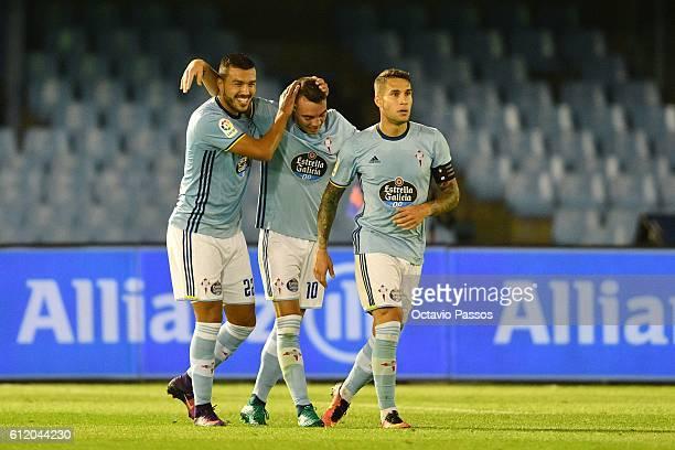 Iago Aspas of RC Celta de Vigo celebrates with teammates after scoring a goal against FC Barcelona during the La Liga match between Real Club Celta...