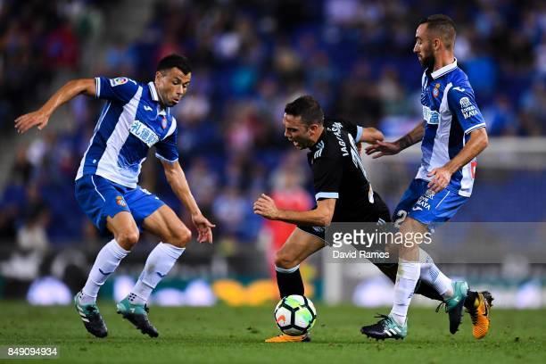 Iago Aspas of RC Celta de Vigo competes for the ball with Javi Fuego and Sergi Darder of RCD Espanyol during the La Liga match between Espanyol and...