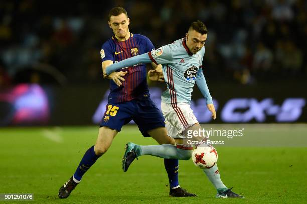 Iago Aspas of RC Celta de Vigo competes for the ball with Thomas Vermaelen of FC Barcelona during the Copa del Rey round of 16 first leg match...