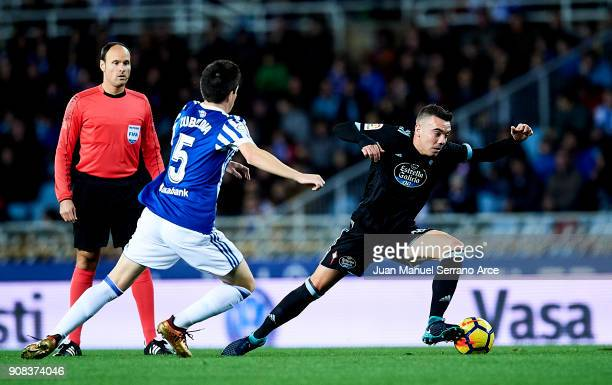 Iago Aspas of RC Celta de Vigo duels for the ball with Igor Zubeldia of Real Sociedad during the La Liga match between Real Sociedad de Futbol and RC...