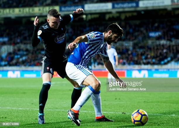 Iago Aspas of RC Celta de Vigo duels for the ball with Raul Rodriguez Navas of Real Sociedad during the La Liga match between Real Sociedad de Futbol...