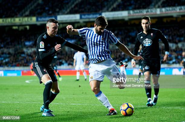 Iago Aspas of RC Celta de Vigo duels for the ball withRaul Rodriguez Navas of Real Sociedad during the La Liga match between Real Sociedad de Futbol...