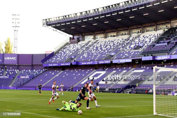 Iago Aspas of RC Celta scores his side's first goal during the La Liga Santander match between Real Valladolid CF and RC Celta at Estadio Municipal...