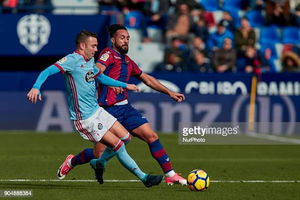 Iago Aspas of Real Club Celta de Vigo competes for the ball with Ivi of Levante UD during the La Liga game between Levante UD and Real Club Celta de...
