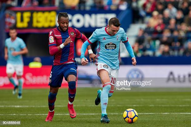 Iago Aspas of Real Club Celta de Vigo competes for the ball with Doukoure of Levante UD during the La Liga game between Levante UD and Real Club...