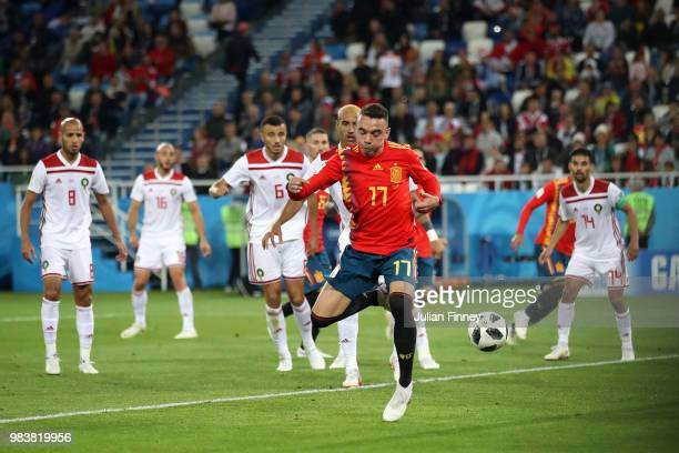 Iago Aspas of Spain back heels in past Monir El Kajoui of Morocco to score his sides second goal during the 2018 FIFA World Cup Russia group B match...