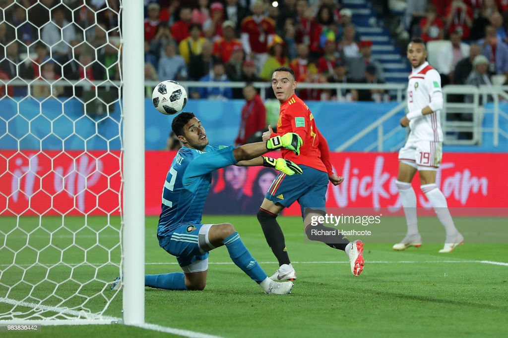 Iago Aspas of Spain back heels in past Monir El Kajoui of Morocco to score his sides second goal during the 2018 FIFA World Cup Russia group B match between Spain and Morocco at Kaliningrad Stadium on June 25, 2018 in Kaliningrad, Russia.