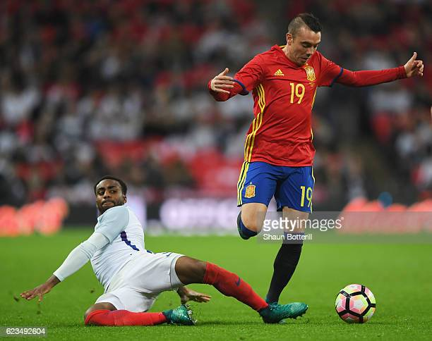 Iago Aspas of Spain battles with Danny Rose of England during the international friendly match between England and Spain at Wembley Stadium on...