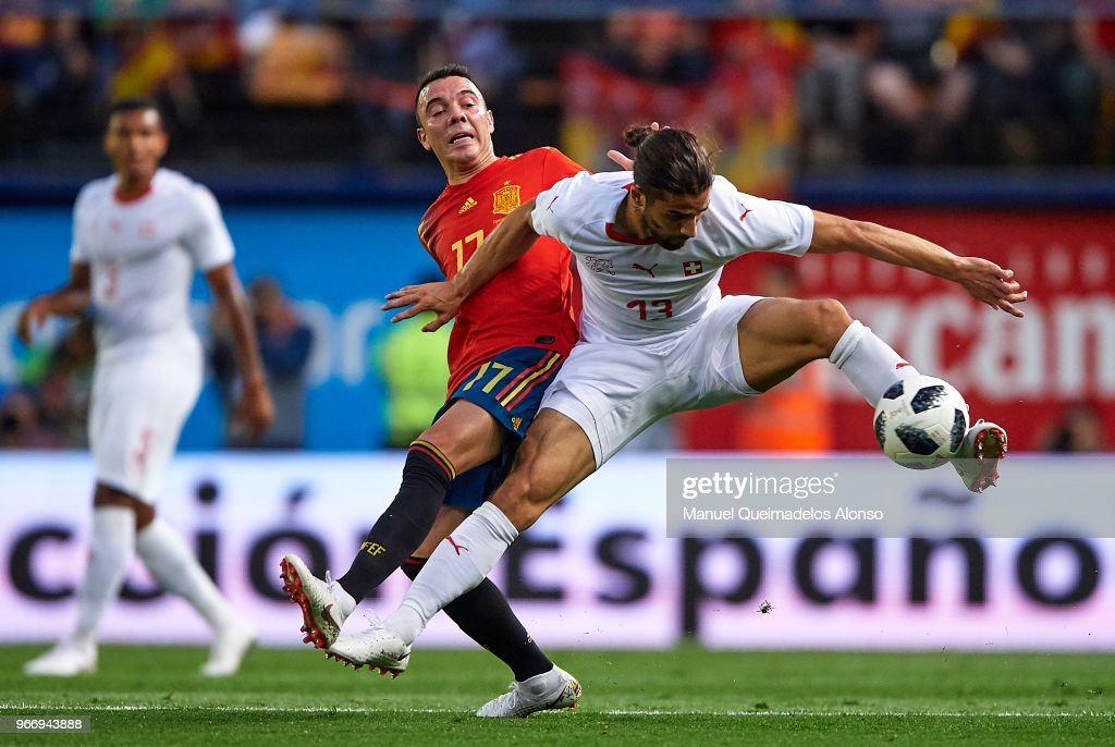 Iago Aspas of Spain competes for the ball with Ricardo Rodriguez (R) of Switzerland during the International Friendly match between Spain and Switzerland at Estadio de La Ceramica on June 3, 2018 in Villareal, Spain.
