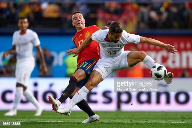 Iago Aspas of Spain competes for the ball with Ricardo Rodriguez of Switzerland during the International Friendly match between Spain and Switzerland...