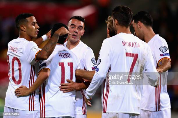 Iago Aspas of Spain is congratulated by his teammates after scoring his sides fifth goal during the FIFA 2018 World Cup Qualifier between...