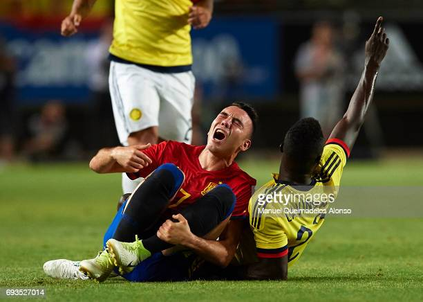 Iago Aspas of Spain is tackled by Davinson Sanchez of Colombia during the international friendly match between Spain and Colombia at Nueva Condomina...