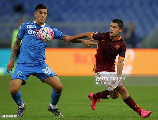Iago Falque of AS Roma competes for the ball with Leandro Paredes of Empoli FC during the Serie A match between AS Roma and Empoli FC at Stadio...