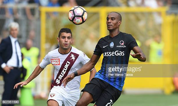 Iago Falque of FC Torino competes for the ball with Abdoulay Konko of Atalanta BC during the Serie a match between Atalanta BC and FC Torino at...