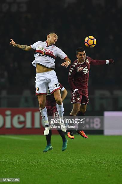 Iago Falque of FC Torino goes up with Lucas Ocampos of Genoa CFC during the Serie A match between FC Torino and Genoa CFC at Stadio Olimpico di...