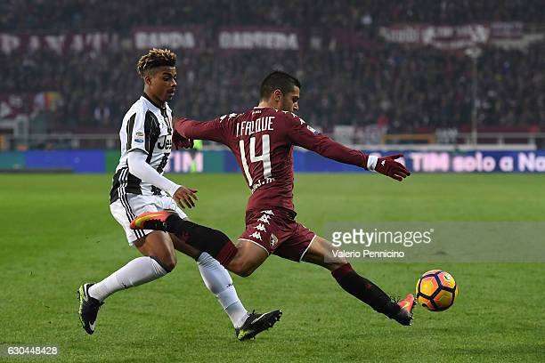 Iago Falque of FC Torino in action against Mario Lemina of Juventus FC during the Serie A match between FC Torino and Juventus FC at Stadio Olimpico...