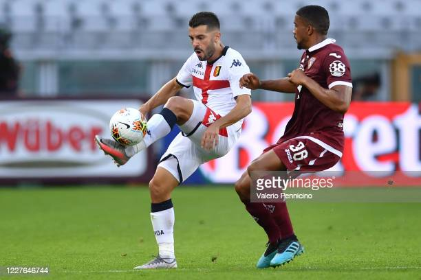 Iago Falque of Genoa CFC is challenged by Gleison Bremer of Torino FC during the Serie A match between Torino FC and Genoa CFC at Stadio Olimpico di...