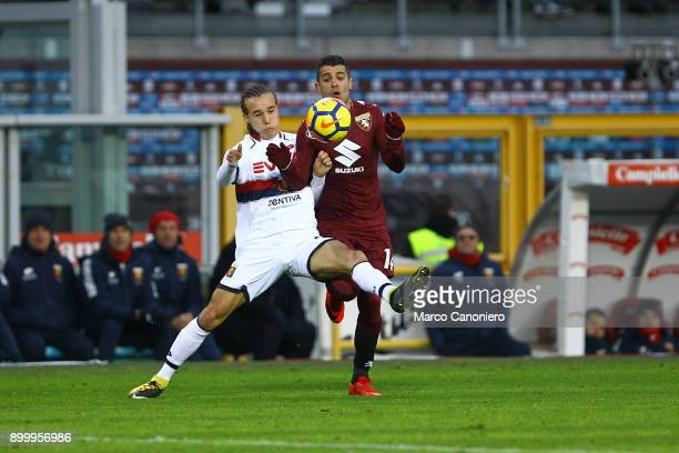 Iago Falque of Torino FC and Diego Laxalt of Genoa Cfc in action during the Serie A football match between Torino Fc and Genoa Cfc