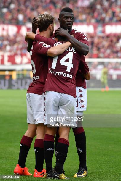 Iago Falque of Torino FC celebrates after scoring the opening goal with team mate Cristian Ansaldi and M Baye Niang during the Serie A match between...