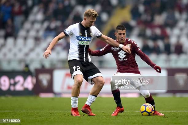 Iago Falque of Torino FC competes for the ball with Antonin Barak of Udinese Calcio during the Serie A football match between Torino FC and Udinese...