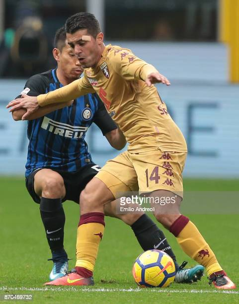 Iago Falque of Torino FC competes for the ball with Yuto Nagatomo of FC Internazionale Milano during the Serie A match between FC Internazionale and...