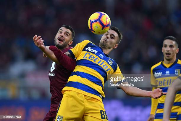 Iago Falque of Torino FC competes with Alberto Grassi of Parma Calcio during the Serie A match between Torino FC and Parma Calcio at Stadio Olimpico...