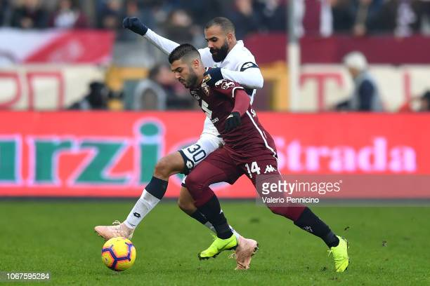 Iago Falque of Torino FC competes with Sandro of Genoa CFC during the Serie A match between Torino FC and Genoa CFC at Stadio Olimpico di Torino on...