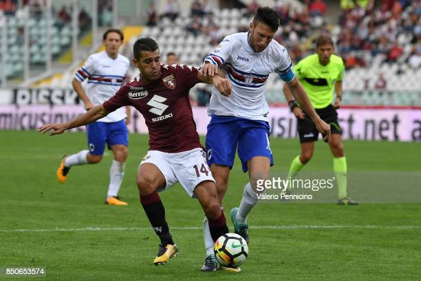 Iago Falque of Torino FC competes with Vasco Regini of UC Sampdoria during the Serie A match between Torino FC and UC Sampdoria at Stadio Olimpico di...