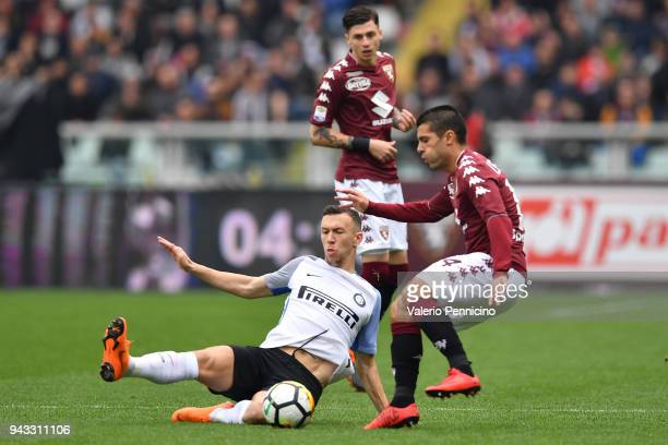 Iago Falque of Torino FC is tackled by Ivan Perisic of FC Internazionale during the Serie A match between Torino FC and FC Internazionale at Stadio...