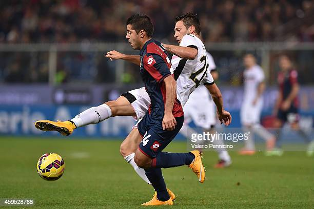 Iago Falque Silva of Genoa CFC is challenged by Franco Vazquez of US Citta di Palermo during the Serie A match between Genoa CFC and US Citta di...