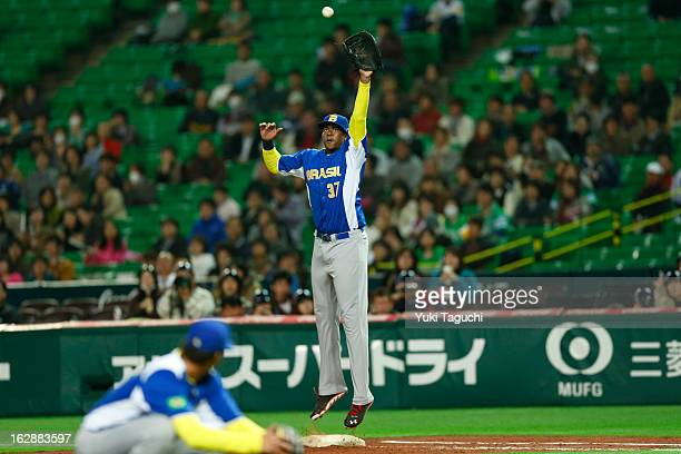 Iago Januario of Team Brazil makes a leaping catch during the World Baseball Classic exhibition game against the SoftBank Hawks at the Fukuoka Yahoo...